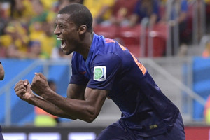 Netherlands' Georginio Wijnaldum, right, celebrates with Jonathan de Guzman after scoring his side's third goal during the World Cup third-place soccer match between Brazil and the Netherlands at the Estadio Nacional in Brasilia, Brazil, Saturday,