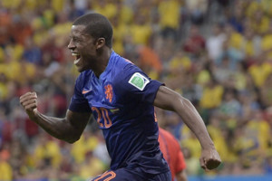 Netherlands' Georginio Wijnaldum celebrates after scoring his side's third goal during the World Cup third-place soccer match between Brazil and the Netherlands at the Estadio Nacional in Brasilia, Brazil, Saturday, July 12, 2014. Netherlands beat