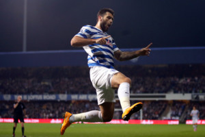 Queens Park Rangers' Charlie Austin celebrates scoring the opening goal of game during the Barclays Premier League match at Loftus Road, London.