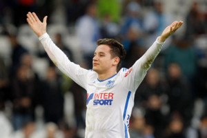 Marseille's French midfielder Florian Thauvin, waves to supporters after defeating Nantes during their League One soccer match, at the Velodrome Stadium, in Marseille, southern France, Friday, Nov. 28, 2014. (AP Photo/Claude Paris)