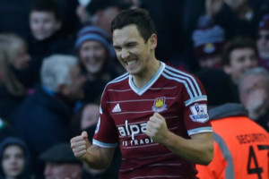 West Ham's Stewart Downing celebrates after scoring his side's third goal during the English Premier League soccer match between West Ham and Hull City at Upton Park stadium in London, Sunday, Jan. 18, 2015. (AP Photo/Matt Dunham)