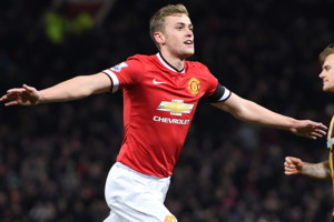 Manchester United's James Wilson celebrates scoring his side's third goal during the FA Cup, Fourth Round replay at Old Trafford, Manchester. PRESS ASSOCIATION Photo. Issue date: Tuesday February 3, 2015. See PA story SOCCER Man Utd. Photo credit