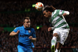 Celtic's Jason Denayer, right, vies for the ball with Inter Milan's Mauro Icardi, left, during their Europa League first leg of round of 32 soccer match at Celtic Park, Glasgow, Scotland, Thursday, Feb. 19, 2015. (AP Photo)