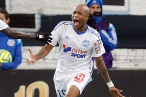 Marseille's Ghanaian forward Andre Ayew, right, reacts with Marseille's French defender Benjamin Mendy, after scoring against Caen, during the League One soccer match between Marseille and Caen, at the Velodrome Stadium, in Marseille, southern Fra