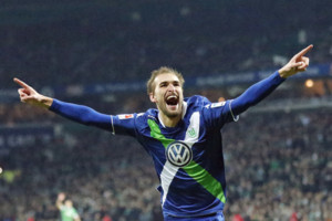 Wolfsburg's Bas Dost from the Netherlands celebrates after scoring during the German first division Bundesliga soccer match between Werder Bremen and VfL Wolfsburg in Bremen, Germany, Sunday, March 1, 2015. (AP Photo/Frank Augstein)