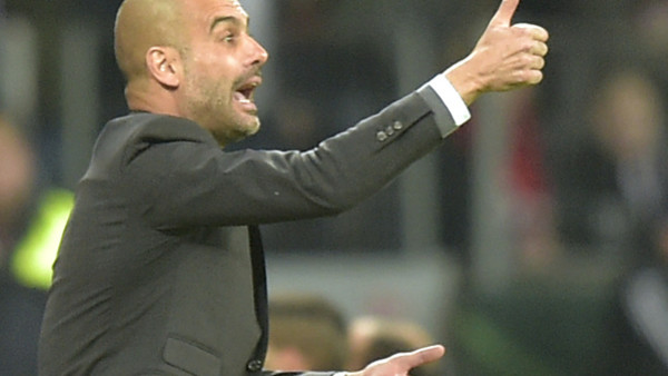 Bayern's head coach Pep Guardiola directs his players during a German soccer cup quarter final match between Bayer 04 Leverkusen and Bayern Munich in Leverkusen, western Germany, Wednesday, April 8, 2015. (AP Photo/Martin Meissner)