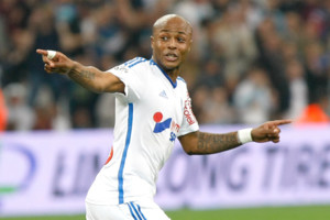 Marseille's Ghanaian forward Andre Ayew, celebrates after scoring against Lorient , during the League One soccer match between Marseille and Lorient, at the Velodrome Stadium, in Marseille, southern France, Friday, April 24, 2015. (AP Photo/Claude Par