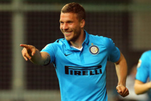 Inter Milan's Lukas Podolski celebrates after scoring during a Serie A soccer match between Udinese and Inter Milan at the Friuli stadium in Udine, Italy, Tuesday, April 28, 2015. (AP Photo/Paolo Giovannini)