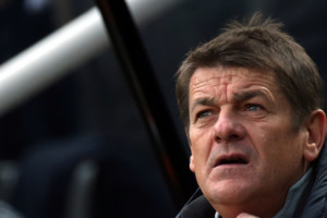 Newcastle United's head coach John Carver awaits the start of their English Premier League soccer match between Newcastle United and West Bromwich Albion at St James' Park, Newcastle, England, Saturday, May 9, 2015. (AP Photo/Scott Heppell)