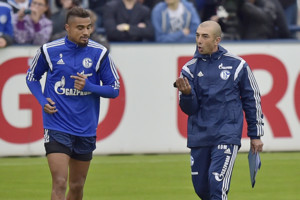 FILE - In this Oct. 9, 2014 file photo new head coach Roberto Di Matteo, right, advises player Kevin-Prince Boateng from Ghana at his first training session of Bundesliga soccer club FC Schalke 04 in Gelsenkirchen, Germany. Schalke says Monday, May 11, 20
