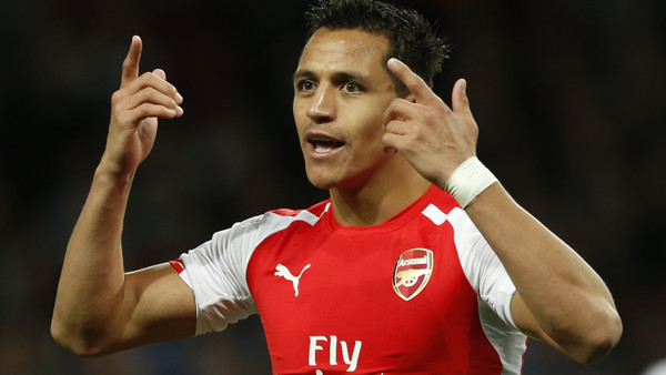 Arsenal's Alexis Sanchez gestures toward the assistant referee as he disputes a decision during their English Premier League soccer match between Arsenal and Swansea City at the Emirates stadium in London, Monday,May 11, 2015. (AP Photo/Alastair Grant