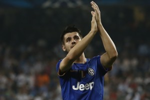 Juventus' Alvaro Morata applauds supporters at the end of the Champions League second leg semifinal soccer match between Real Madrid and Juventus, at the Santiago Bernabeu stadium in Madrid, Wednesday, May 13, 2015. The match ended in a 1-1 draw and J