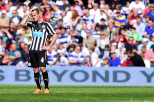 Newcastle United's Ryan Taylor appears dejected after Queens Park Rangers' score their second goal during the Barclays Premier League match at Loftus Road, London.