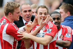 Sunderland's manager Paolo Di Canio, center, celebrates with David Vaughan, right, after scoring his goal during their English Premier League soccer match against Newcastle United at St James' Park, Newcastle, England, Sunday, April 14, 2013. (AP
