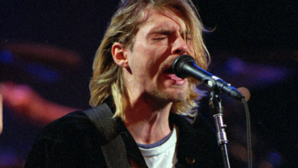FILE - This Dec. 13, 1993 file photo shows Kurt Cobain of the Seattle band Nirvana performing in Seattle, Wash. It's been two decades since the Nirvana frontman took his own life yet he remains on in the thoughts of those he influenced and entertained