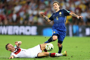 Germany's Bastian Schweinsteiger (left) and Argentina's Lucas Biglia battle for the ball
