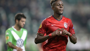 LOSC Lille's Divock Origi, right, celebrates after scoring his side's first goal during the Europa League Group H soccer match between VfL Wolfsburg and LOSC Lille at the Volkswagen Arena stadium in Wolfsburg, Germany, Thursday, Oct. 2, 2014. (AP Photo/Mi