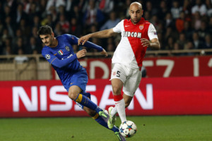 Juventus' Alvaro Morata, left is challenged by Monaco's Aymen Abdennour during the Champions League quarterfinal second leg soccer match between Monaco and Juventus at Louis II stadium in Monaco, Wednesday, April 22, 2015. (AP Photo/Michel Euler)