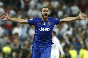 Real Madrid's Leonardo Bonucci elebrates after wining the Champions League second leg semifinal soccer match between Real Madrid and Juventus, at the Santiago Bernabeu stadium in Madrid, Wednesday, May 13, 2015. (AP Photo/Oscar del Pozo)