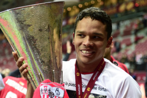 Sevilla Carlos Bacca celebrates with the UEFA Europa League trophy