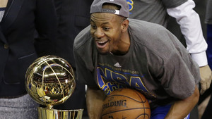 Golden State Warriors guard Andre Iguodala (9) looks at the championship trophy after the Warriors won the NBA Finals against the Cleveland Cavaliers in Cleveland, Wednesday, June 17, 2015. The Warriors defeated the Cavaliers 105-97 to win the best-of-sev