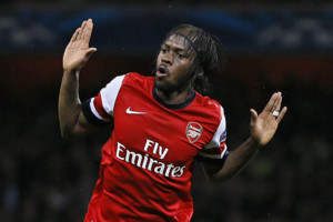 Arsenal's Gervinho celebrates after scoring the opening goal during the Champions League Group B soccer match between Arsenal and Olympiakos at the Emirates Stadium in London, Wednesday, Oct. 3, 2012. (AP Photo/Kirsty Wigglesworth)