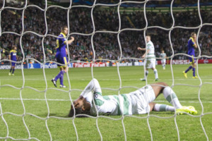 Celtic Kris Commons (left) and Virgil Van Dijk react during the UEFA Champions League Qualifying Play Off, second leg match at Celtic Park, Glasgow.