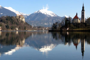 In this photo taken Tuesday, Jan. 27, 2015, shows Lake Bled in Slovenia with a island and the Church of Our Lady on it. Tucked in the southwestern corner of Slovenia, between Austria and Italy, stands a spectacular landscape: a lush tiny island in the mid