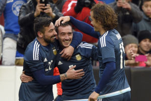 Argentina's Federico Mancuello, center, celebrates his goal with Ezequiel Lavezzi, left, and Lucas Orban, right, during the second half of an international soccer friendly against El Salvador, Saturday, March 28, 2015, in Landover, Md. Argentina won 2
