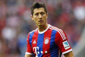 Bayern's Robert Lewandowski from Poland watches his teammates during the German first division Bundesliga soccer match between FC Bayern Munich and Hertha BSC at the Allianz Arena in Munich, Germany, on Saturday, April 25, 2015. (AP Photo/Matthias Sch