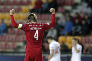 Denmarks Jannik Vestergaard celebrates victory after the Euro U21 soccer championship group A match between Denmark and Serbia, at the Letna stadium in Prague, Czech Republic, Tuesday, June 23, 2015. (AP Photo/Petr David Josek)