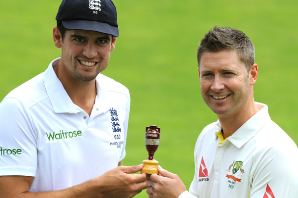 England captain Alastair Cook, left, and Australia captain Michael Clarke pose with the Ashes Trophy ahead of the first Ashes Test match, in Cardiff, Wales, Tuesday, July 7, 2015. (AP Photo/Rui Vieira)
