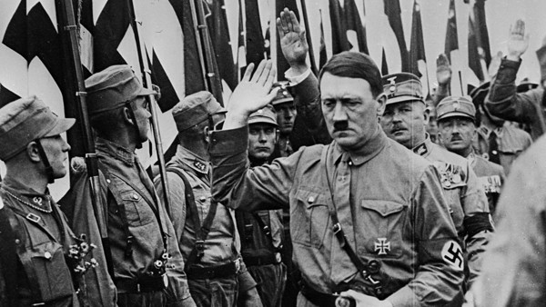 Fiery young leader of the German fascist movement, Adolf Hitler, gives a Nazi salute during a field day in Brunswick, Germany, Oct. 27, 1931. The Nazi chief attacked the present government in an address that climaxed in a parade in which over 100,000 of H