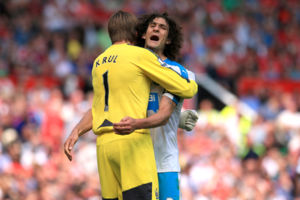 Newcastle United's Fabricio Coloccini and goalkeeper Tim Krul celebrate their clean sheet after the final whistle during the Barclays Premier League match at Old Trafford, Manchester.