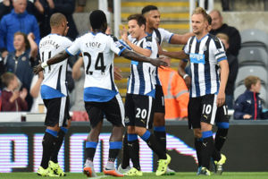 Newcastle's Siem De Jong celebrates with team mates after scoring his side second goal during the Capital One Cup, second round match at St James' Park, Newcastle.