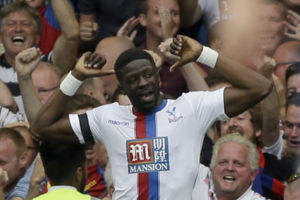 Crystal Palace's Bacary Sako, 26, celebrates scoring his side's first goal during the English Premier League soccer match between Chelsea and Crystal Palace at Stamford Bridge stadium in London, Saturday, Aug. 29, 2015. (AP Photo/Matt Dunham)