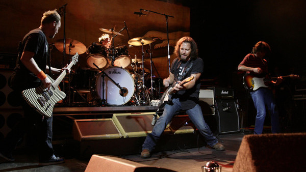 EDITORIAL USE ONLY. Pearl Jam, with lead singer Eddie Vedder (centre), performing on stage at the O2 Shepherds Bush Empire in west London.