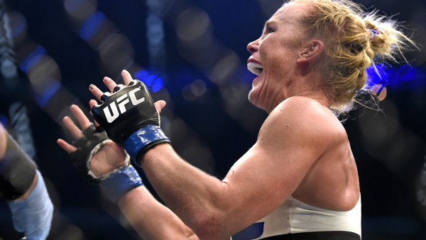 Holly Holm celebrates after defeating Ronda Rousey during thier UFC 193 bantamweight title fight in Melbourne, Australia, Sunday, Nov. 15, 2015. (AP Andy Brownbill)