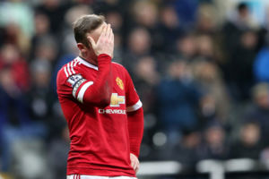 Manchester United's captain Wayne Rooney stands dejected after missing a chance to score during the English Premier League soccer match between Newcastle United and Manchester United at St James' Park, Newcastle, England, Tuesday, Jan. 12, 2015. (