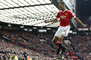 Manchester United's Marcus Rashford, celebrates after he sores the opening goal of the game during the English Premier League soccer match between Manchester United and Arsenal at Old Trafford Stadium, Manchester, England, Sunday, Feb. 28, 2016. (AP P