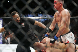 Referee Herb Dean stops the fight shortly after Nate Diaz defeats Conor McGregor in a second round submission victory during their UFC 196 welterweight mixed martial arts match, Saturday, March 5, 2016, in Las Vegas. Diaz won by submission. (AP Photo/Eric