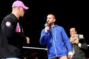 CM Punk Paul Heyman John Cena 2012.jpg