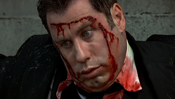 john travolta face off